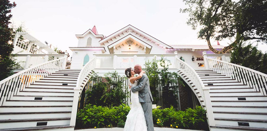Couple Kissing in front of Tybee Wedding Chapel
